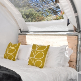 Glamping pod bed and window