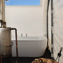 Wood burning water heater in glamping pod