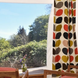Window and curtain in glamping pod